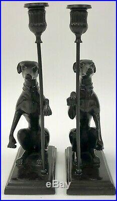 A Vintage Pair of Brass / Bronze Seated Greyhound Candlesticks