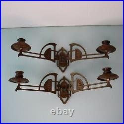 Art Nouveau pair of brass wall candle holders