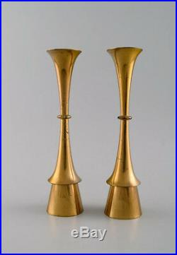 Jens Quistgaard style of. Danish design, 1960 s. A pair of candlesticks in brass