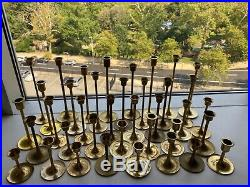 Lot of 38 vintage brass candlesticks from 3 to 9. Wedding, shower