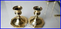 Lot of brass candle sticks. Two Baldwin brass and one Virginia MetalCrafters