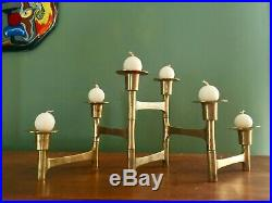 Mid century modern swiveling brass candle holders with vintage juvaha oy candles